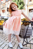 Small baby girl pretty kid happy childhood wear fashion dress Royalty Free Stock Image