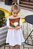 Small baby girl pretty kid happy childhood wear fashion dress Stock Image