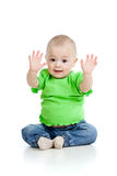 Small baby girl with raised hands sitting on floor Royalty Free Stock Photography