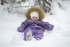 Small baby girl in the snow. Winter Cold First Happy New Year Merry Christmas Forest White Royalty Free Stock Images