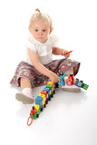 Small baby girl with a toy Royalty Free Stock Photos