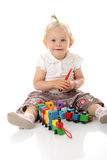 Small baby girl with a toy Stock Photos