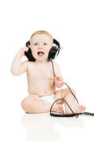 The small baby in headphones Royalty Free Stock Images