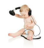 The small baby in headphones Stock Photos