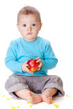Small baby holding red apple royalty free stock images