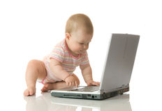 Small baby with laptop #13 Royalty Free Stock Images