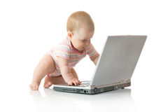 Small baby with laptop isolated  Royalty Free Stock Images