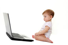 Small baby with laptop isolated on white Royalty Free Stock Photography