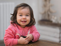 Small baby laughing sincerely Stock Images