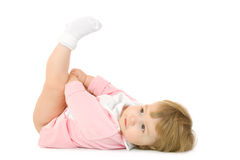 Small baby lay on back and make gymnastic exercise. Isolated Stock Photo