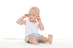 Small baby listening to music. Royalty Free Stock Photos