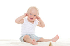 Small baby listening to music. Royalty Free Stock Images