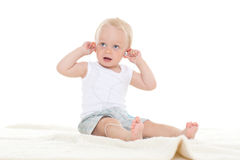 Small baby listening to music. Stock Photo