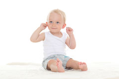 Small baby listening to music. Royalty Free Stock Photography