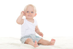 Small baby listening to music. Stock Photography