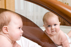 Small baby, looking to a mirror Royalty Free Stock Image