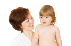 Small baby with mother isolated Royalty Free Stock Photography