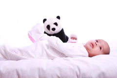 Small Baby playing with soft toy Royalty Free Stock Images