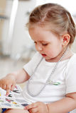 Small baby reading a book. Small baby reading a picture book Royalty Free Stock Image