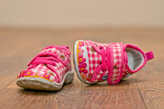 Small baby's shoes on the floor Stock Photography