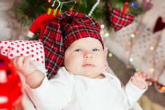Small baby in santa hat Royalty Free Stock Image