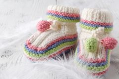 Small baby shoes. On table Royalty Free Stock Images