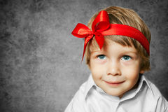 Small baby with silver gift box Royalty Free Stock Images