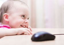 Small baby is sitting at a table Royalty Free Stock Photography