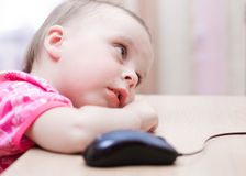 Small baby is sitting at a table Royalty Free Stock Photos