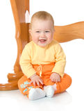 Small baby sitting with table #8 isolated Stock Photos