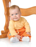 Small baby sitting with table #9 isolated Royalty Free Stock Image