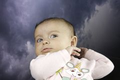 Small Baby with Sky in Background Royalty Free Stock Photography