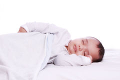 Small baby sleeping Under white blanket. Closeup of small baby while he was sleeping Under white blanket Stock Photography