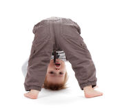 Small baby stands on head royalty free stock photo