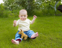 Small baby at summer lawn Stock Photography
