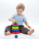 Small baby with a toy pyramid Royalty Free Stock Image