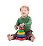 Small baby with a toy pyramid Royalty Free Stock Photography