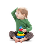 Small baby with a toy pyramid Stock Image