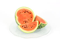 Small baby watermelon cut on a large glass platter Royalty Free Stock Photo