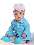 Small baby wearing blue coat Stock Photos