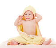 Small baby woth yellow towel Stock Images