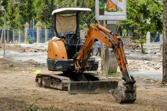 A small backhoe was parked on the construction site. stock photography