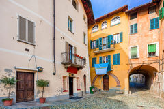 Small backstreet and colorful houses in Italy. Royalty Free Stock Images