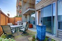 Small backyard area with patio table set Stock Image