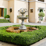 Small backyard fountain in a garden Stock Photos