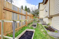 Small backyard garden bed wih wooden trellis Royalty Free Stock Photo