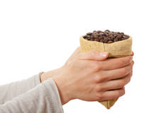 A small bag of coffee beans in female hands Royalty Free Stock Photo