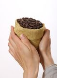 Small bag of coffee beans in female hands Stock Photos