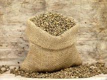 Small bag with hemp seeds Stock Photos
