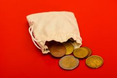 Small bag with money. On red background Royalty Free Stock Image